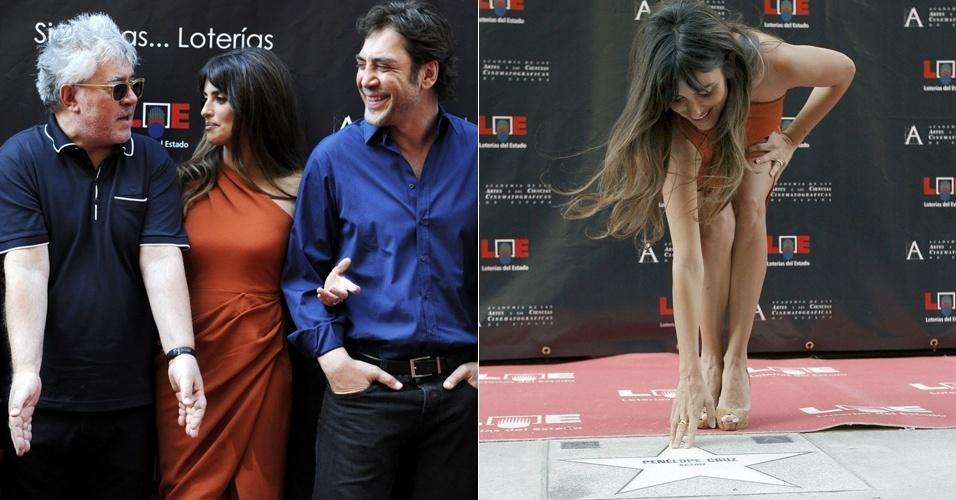 O diretor Pedro Almodovár, a atriz Penelope Cruz e o marido, o ator Javier Bardem, estreiam calçada da fama de Madri (27/6/2011)