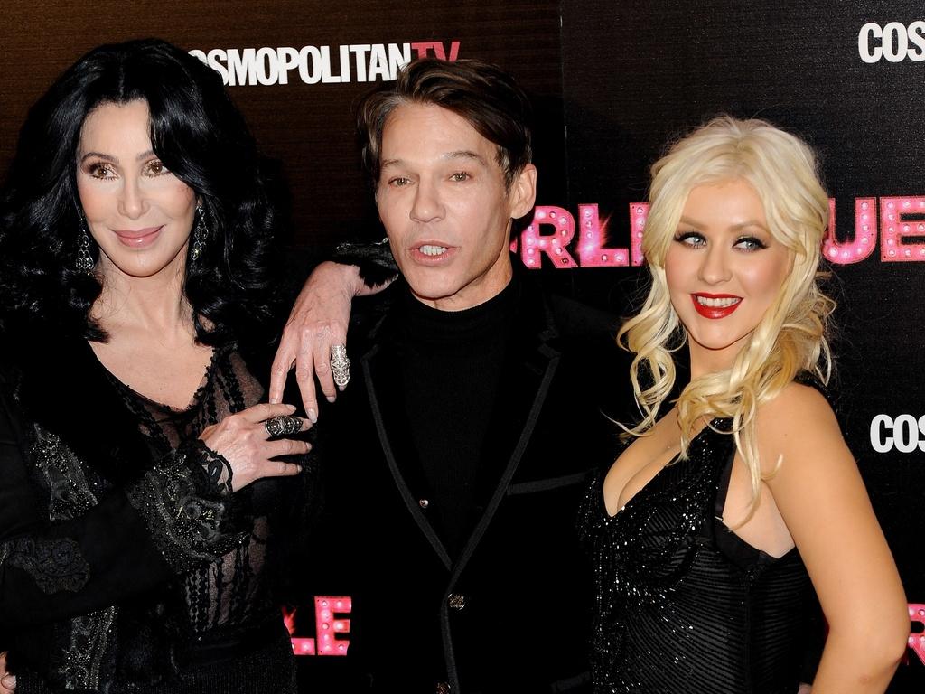 Cher, o diretor Steven Antin e Christina Aguilera posam juntos em première de ''Burlesque'' em Madri, na Espanha (9/12/2010)